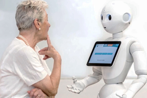 an older woman looks at a robot's chest computer screen